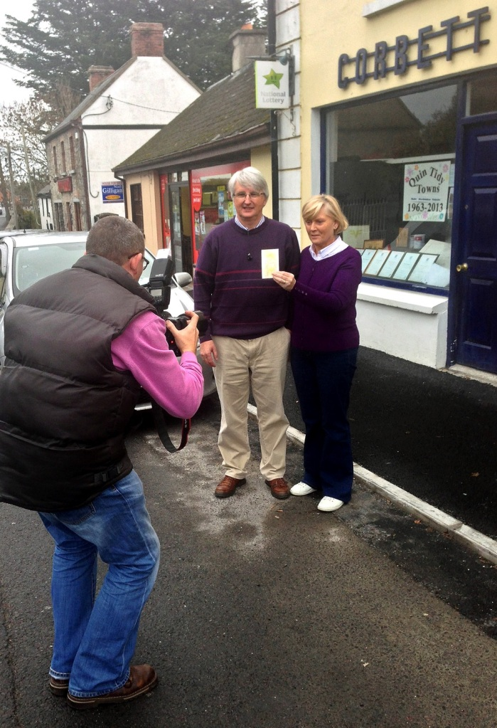 Michael and Anne Corbett pose for a photographer outside their shop in Quin where Saturday's Lotto jackpot winning ticket was purchased.