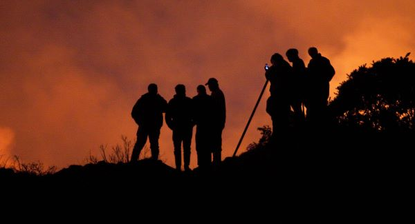 Locals look on as fire crews battle to bring gorse and forestry fires under control on Mt Callan in Co Clare. Picture: Pat Flynn
