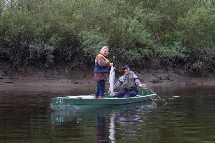 Wild salmon commercial fisherman, Mick Murphy pictured with Burren Smokehouse owner Birgitta Hedin-Curtin on the River Nore at Inistioge, Co. Kilkenny. Photograph Imen McDonnell