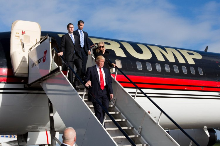 Donald Trump (front)  and family, from left: sons Eric and Donald Jnr and daughter Ivanka are pictured after landing from his personally customised 757 at Shannon Airport.  Pic Sean Curtin Photo.
