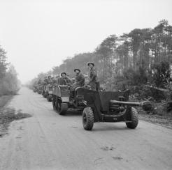 Carriers and 6-pdr anti-tank guns of the 2nd Gordon Highlanders, 15th (Scottish) Division, during the assault on Tilburg, Holland, 28 October 1944.