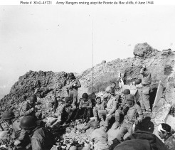 "U.S. Army Rangers rest atop the cliffs at Pointe du Hoc, which they stormed in support of ""Omaha"" Beach landings on ""D-Day"", 6 June 1944."