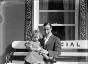 Lieutenant Cesare Sabell with a local child