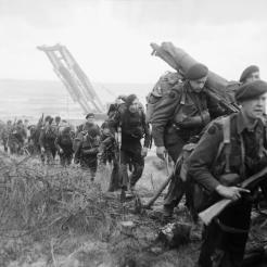 Royal Marine Commandos attached to 3rd Infantry Division move inland from Sword Beach, 6 June 1944