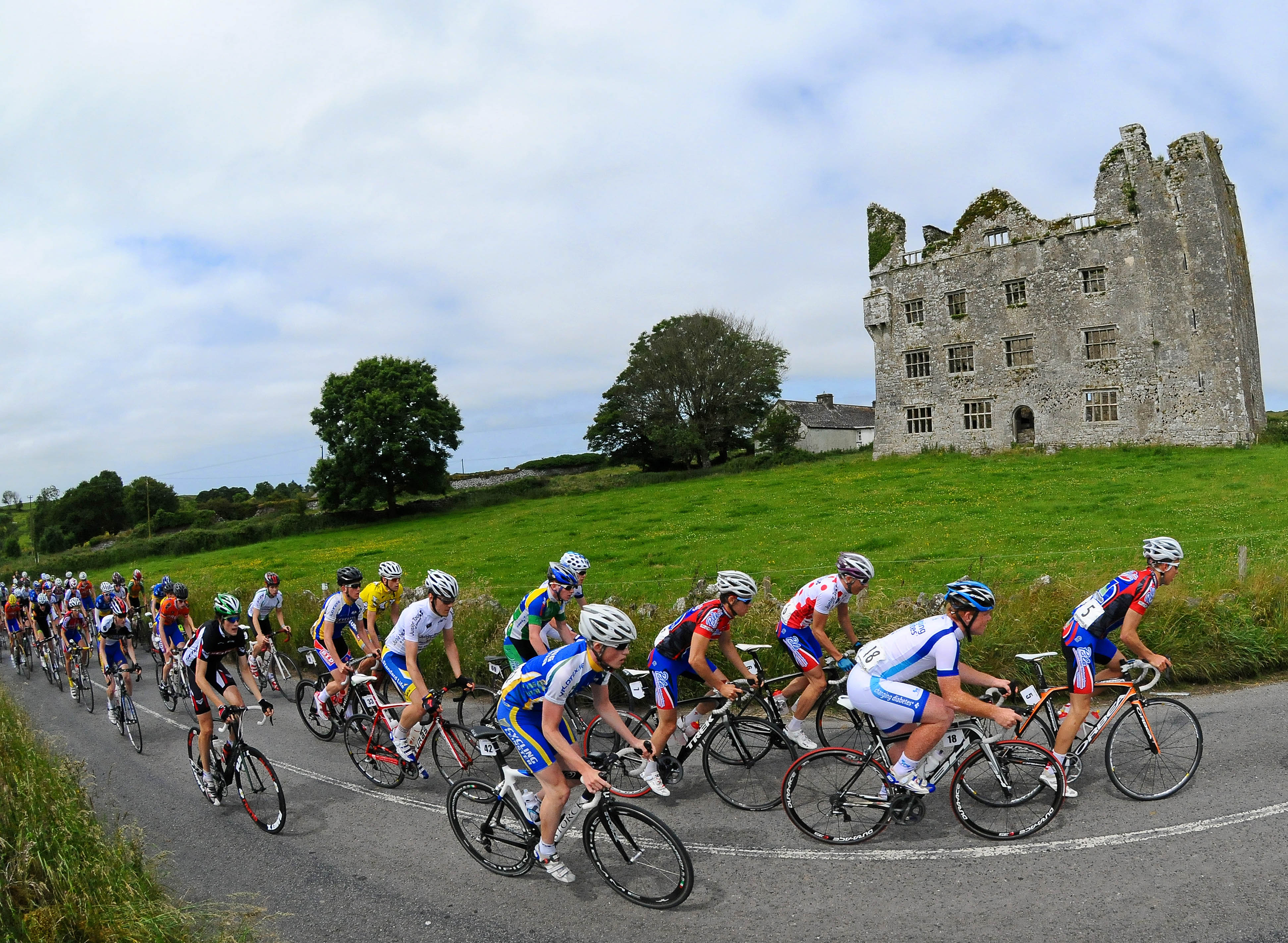 A general view of the action as the peloton pass the ruins of Leamaneh Castle during Stage 4 on the 2013 Junior Tour of Ireland, Ennis - Ennis, Co. Clare. Picture credit: Stephen McMahon / SPORTSFILE