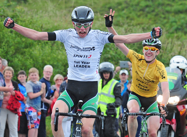 Michael O'Loughlin, Team Ireland, left, celebrates as he approaches the finishline to take victory on Stage 5 of the 2014 International Junior Tour of Ireland, Ennis - Gallows Hill, Co. Clare. Picture credit: Stephen McMahon / SPORTSFILE