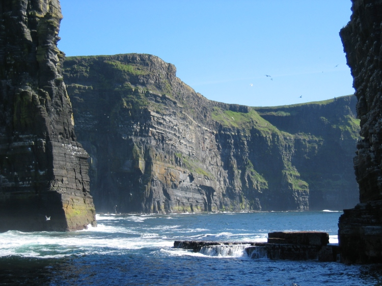 The surfer managed to make it to a small beach at the base of the the cliffs