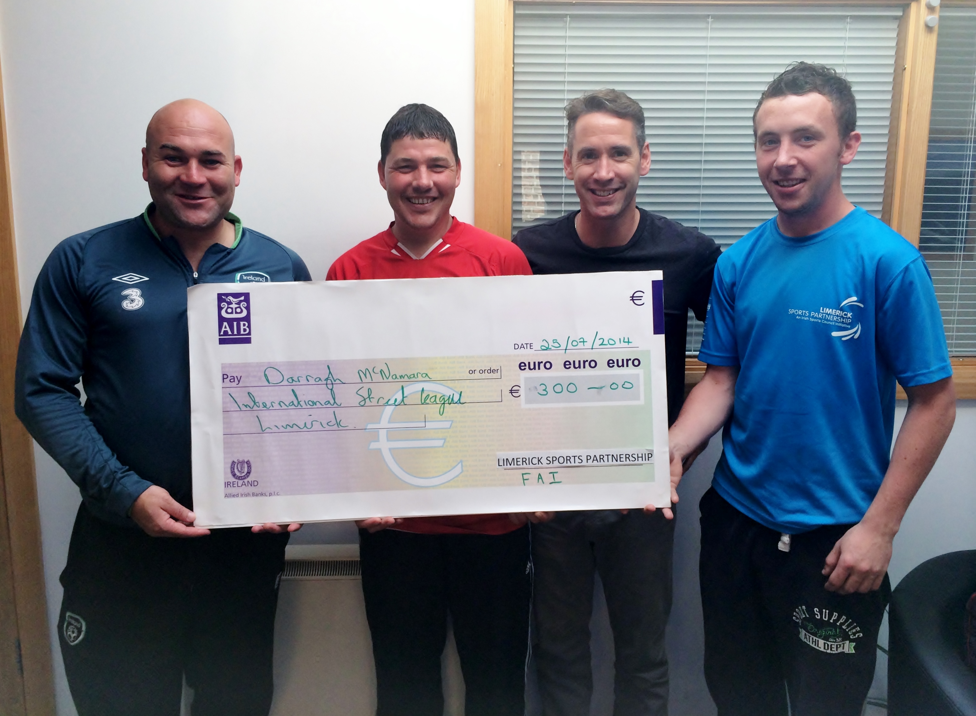 Darragh McNamara, Hill Celtic player and member of Southill Outreach Programme (pictured centre) receives a cheque for 300 euro following the Limerick World Cup, held in Annacotty last week. Also pictured is L-R Jason O'Connor, FAI Development Officer; David McPhillips, Community Substance Misuse Team (CSMT); and Padraig Reale, Limerick Sports Partnership.