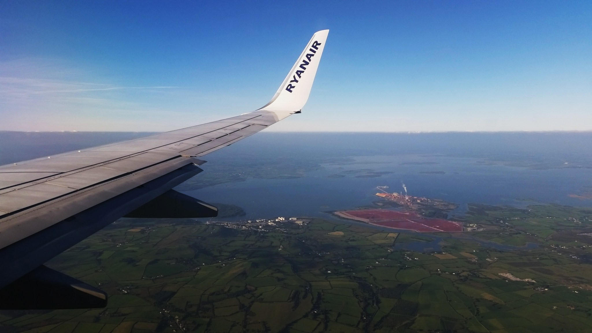 A Ryanair flight over Aughinish Alumina before crossing over the Shannon Estuary and landing in Shannon Airport. Photo Mark Dunphy