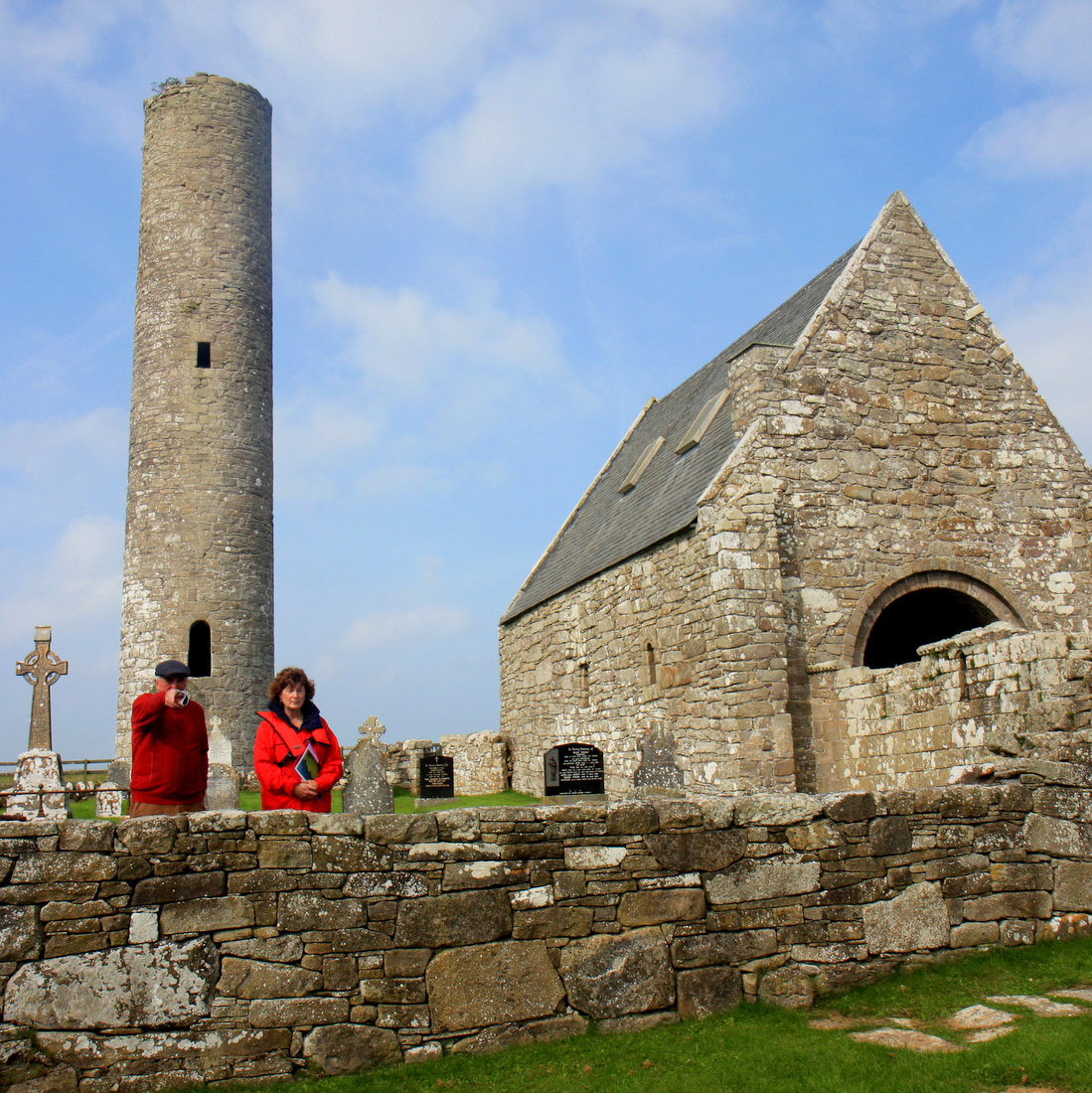 Gerard Madden, Holy Island Tours and Dawn Livingstone, CEO, Waterways Ireland photographed outside St. Caimin's Church and Round Tower on Holy Island during a visit to the Lough Derg island. Photograph by Gordon Daly