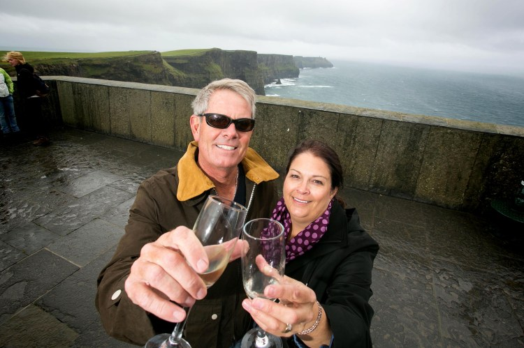 Pictured at the Cliffs of Moher observation point in October was one millionth Cliffs visitor Rita Shaw with her husband Stephen. Pic Arthur Ellis.