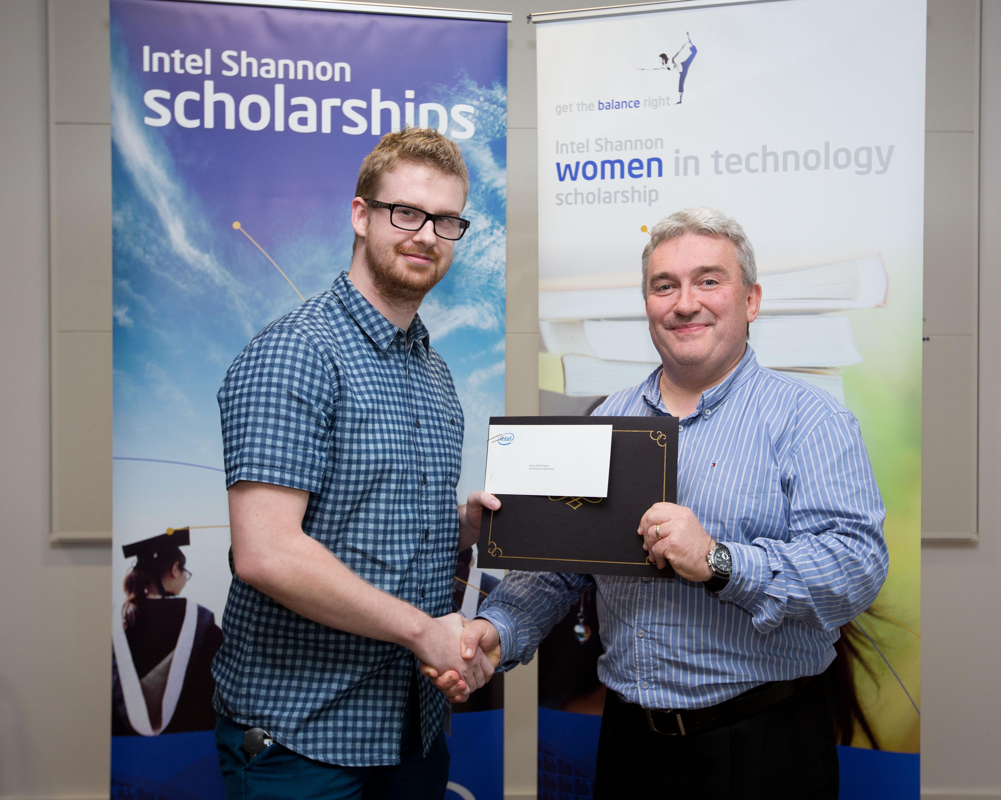 Michael Hennessey presents Aaron Hetherington with an Intel Scholarship at Intel ninth ÒWomen in TechnologyÓ award ceremony held at Intel in Shannon. Pic Sean Curtin Photo.