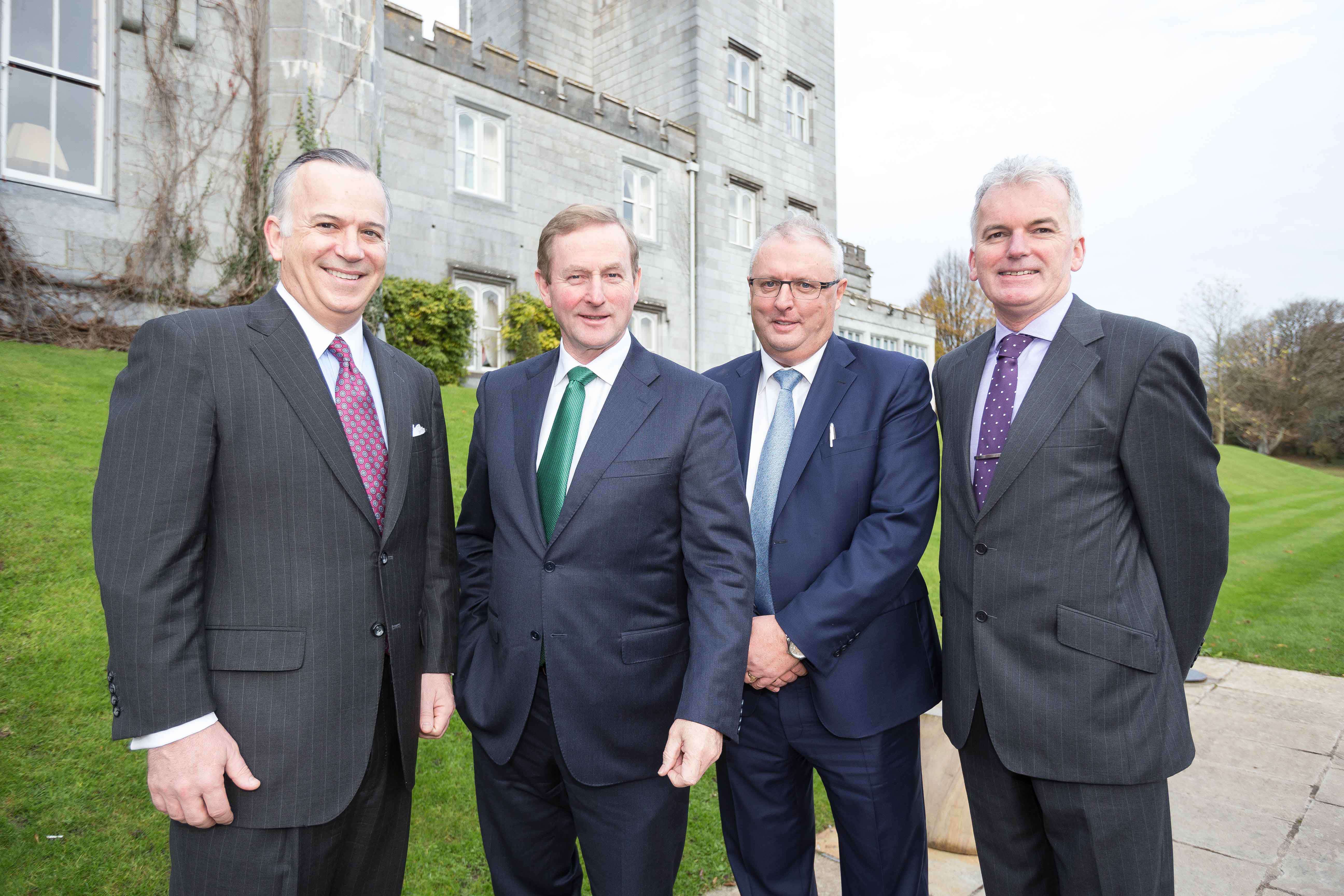 An Taoiseach Enda Kenny T.D., pictured at Shannon Chamber president's lunch at Dromoland Castle with (from left): Tom McInerney, chief executive, Genworth Financial Inc; Bob Brannock, president, international protection, Genworth; and Kevin Thompstone, president, Shannon Chamber. Photo: Eamon Ward.
