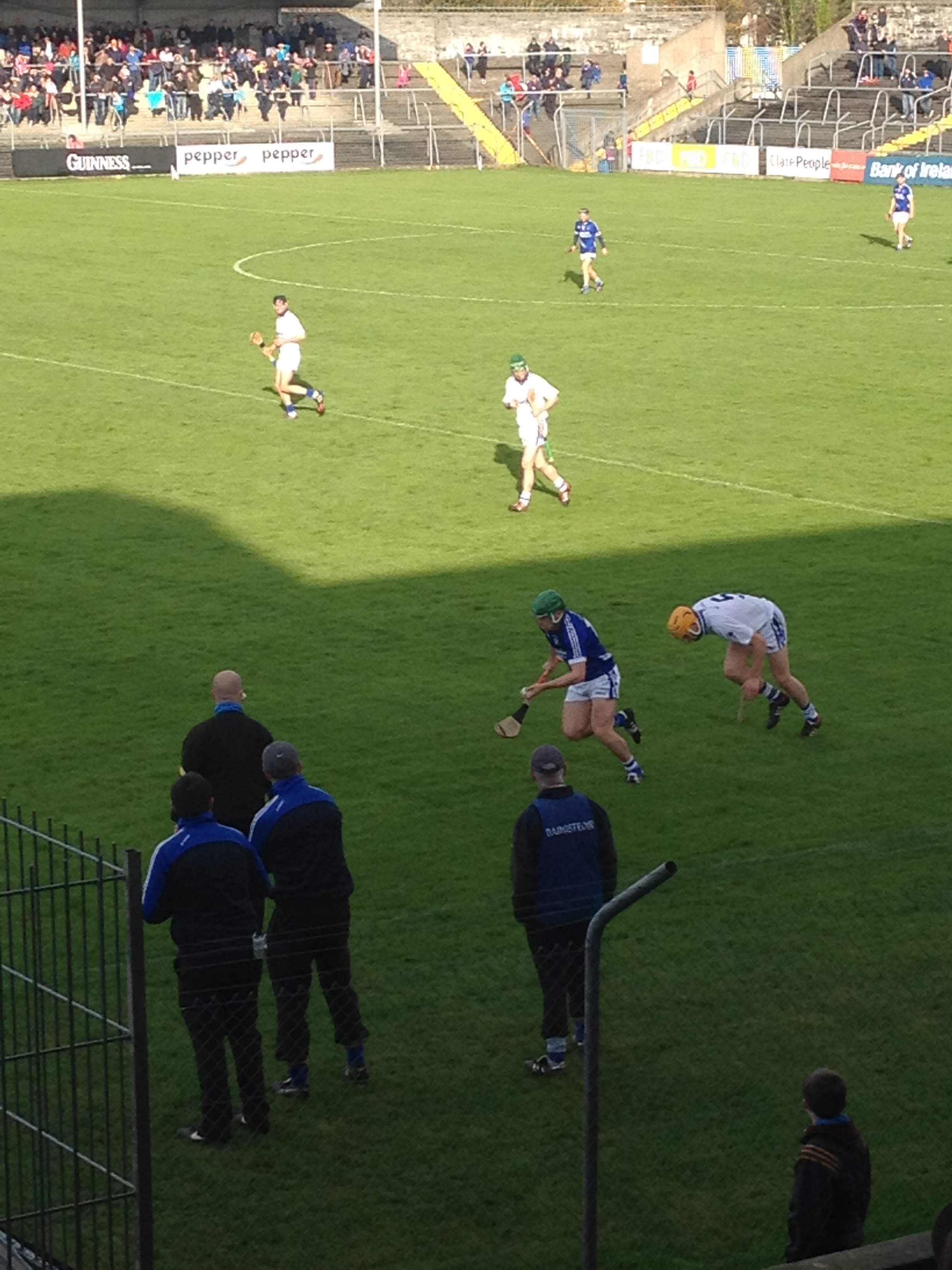 Sean Collins races away from Ronan Maher