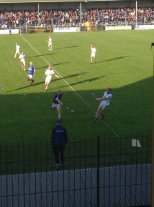 Michael Cahill clears his lines despite the best efforts of Cathal Mc Inerney