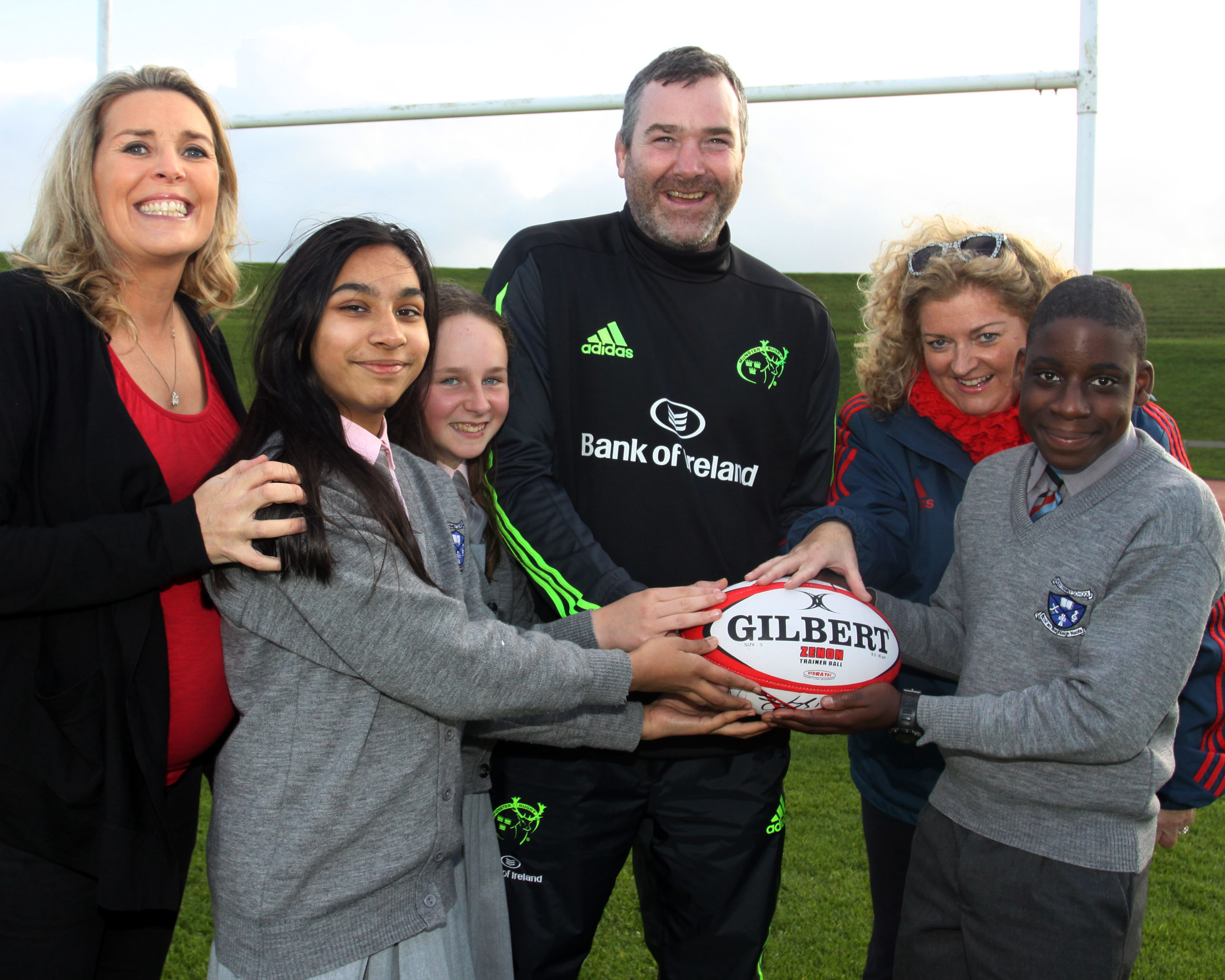 Munster Manager, Anthony Foley gives Cara O'Sullivan and the students of Holy Family Senior School, Jesus Quaye Saya, Simran Inayat and Shannon Hegarty with Anne  Riordan, Iriish Heart Foundation, with some game tips for their concert which is to be held in the Cathedral in Ennis on the 29th of November. Picture Brendan Gleeson