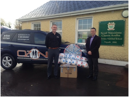 Ozone General Manager, Micheal Hogan presenting some of the equipment to Clooney N.S. Principal, Deasun Hennessy