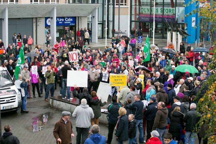 Crowds gather to take part in the Water Charges Protest in Shannon Town centre in Co Clare. Pic Arthur Ellis.