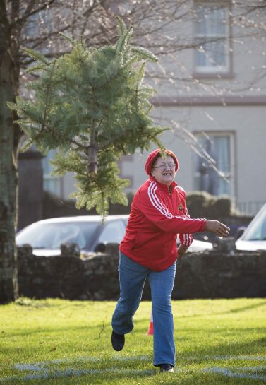 Former Councillor Patricia McCarthy taking part in the 3rd annual Christmas Tree throwing Championships in Aid of Cystic Fibrosis at Tim Smyth Park, Ennis. Photograph by Eamon Ward