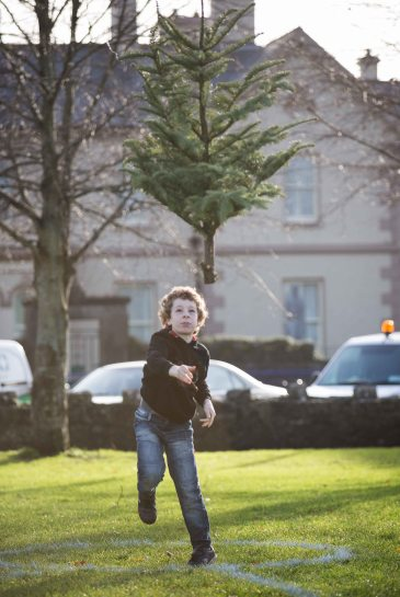 9 year old Callan McCafferty, Ennis taking part in the 3rd annual Christmas Tree throwing Championships in Aid of Cystic Fibrosis at Tim Smyth Park, Ennis. Photograph by Eamon Ward