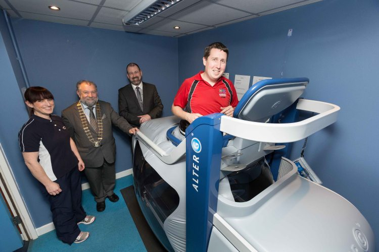 John Carey, Gym Manager along with Tim Forde , General manager and Anne-Marie Kinsella, Chartered Physio Therapist demonstrating the new anti-gravity AlterG treadmill at Active Ennis Leisure complex for John Crowe, Cathaoirleach Clare County Council this week. Photograph by Eamon Ward