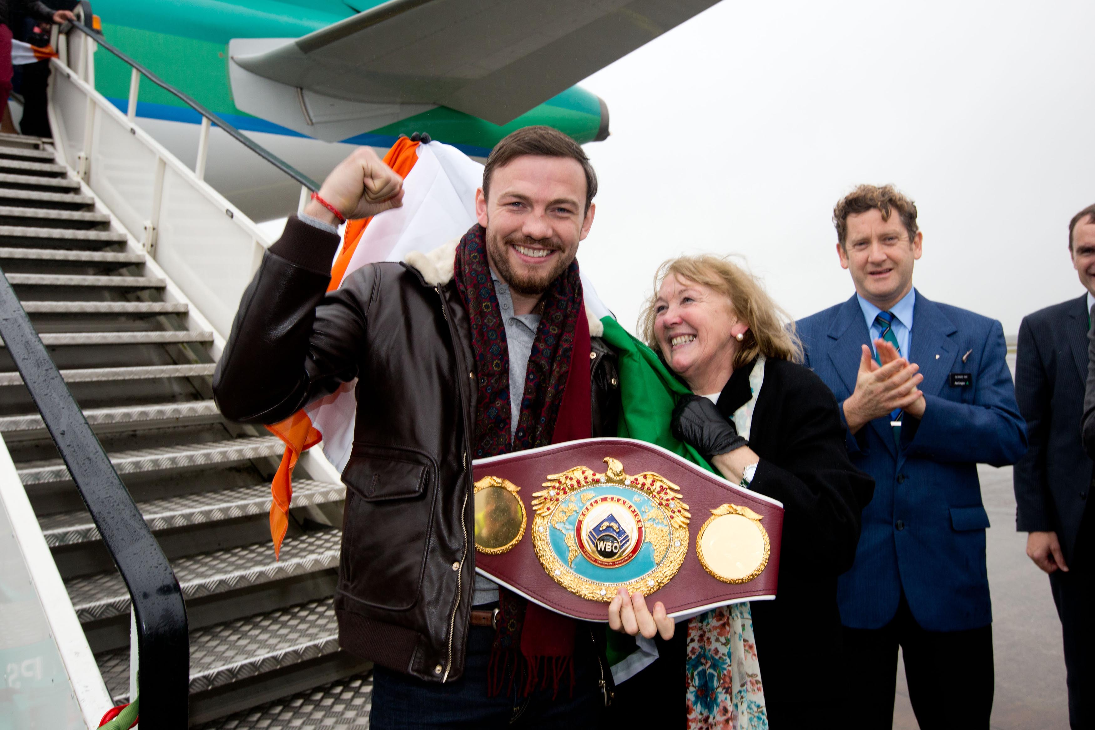 World middleweight boxing champion Andy Lee was greeted off the plane by his mother Anne when he arrived back to a heroes welcome at Shannon Airport before join on to Limerick City Hall for a civic reception. Pic Sean Curtin Photo