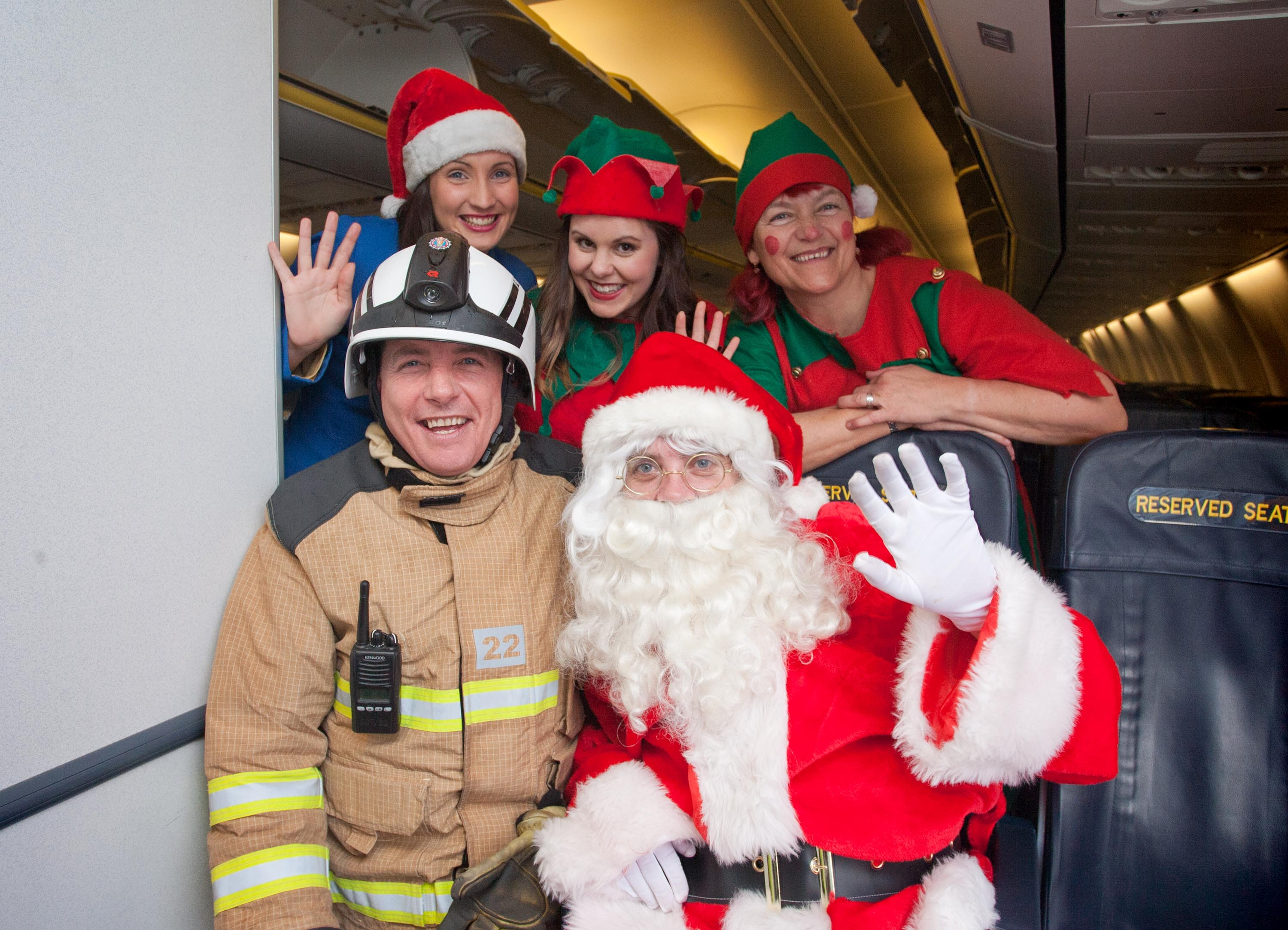 Pictured onboard at Shannon Airport with Santa Claus are Airport Fire Officer Pat O'Neill, Ryanair Cabin Crew , Catherine Browne and Elves Jeanette McKee and Fran Minter.Pic Arthur Ellis - http://www.arthurellisphotography.ie/