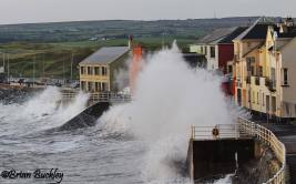 Waves crash against the Promenade at Lahinch. Photo Brian Buckley.