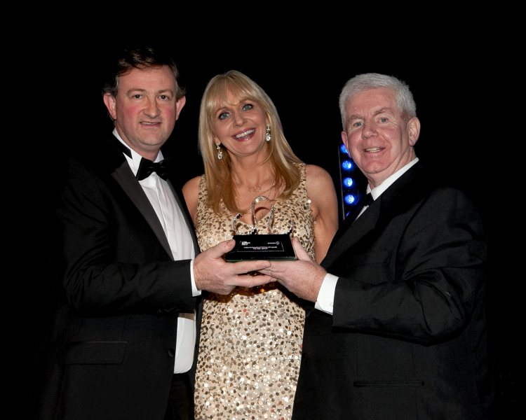 Clare Champion photographer John Kelly has won First prize in the Portrait Category of the Press Photographer of the Year Awards 2015 Pictured (above) at the Press Photographers Association of Ireland (PPAI) in the Ballsbridge Hotel with MC Miriam O'Callaghan and Ray McManus, President, PPPI. Picture credit: Chris Bellew / Fennell Photography