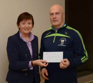 Brenda Nicholson (Finance Manager CareerWise Recruitment) presents the cheque to Colm Honan (Senior Camogie manager)