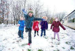 Junior Infants in St Mochullas national school in Tulla Co Clare during a recent cold spell. L-R Patrick Foley, Cillian O'Neill, Hazel O'Mahony, Clodagh Murphy and Ciara Donnellan enjoying the snow in their School garden on Wednesday morning.Pic Arthur Ellis.