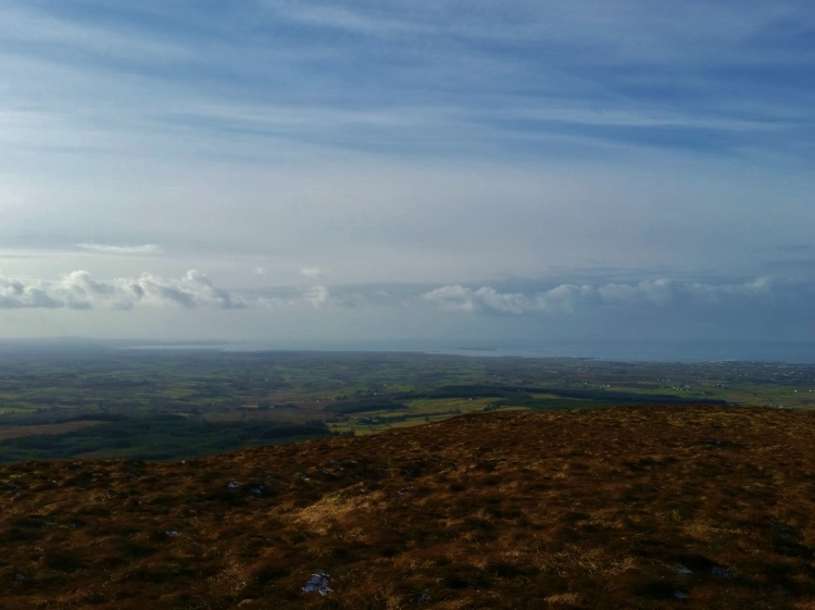 The view from the summit of Mount Callan, West Clare's highest mountain, looking towards Loop Head and Mutton Island