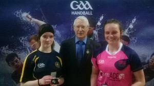 Ella Donnellan (left) receives medal from GAA Handball President Willie Roche