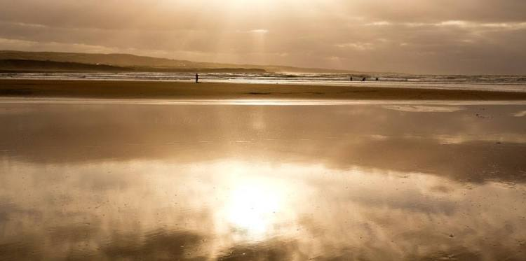 Surfing into the fading light, Lahinch. Image Ann O'Connell