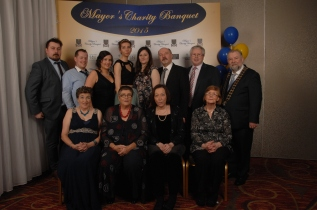 The Crowe family celebrating with Cllr John Crowe at the Mayor's Charity Banquet. Back row (l to r) Alec Hughes, James Hook, Zoe Crowe, Siobhan Crowe, Rachel Hughes, Alec Hughes Snr, Dr Padraic Quinn and Cllr. John Crowe. Front row (l to r) Annette Cowman, Seppie Crowe, Marie Hughes and Evelyn Quinn. Pic by Terry O'Brien