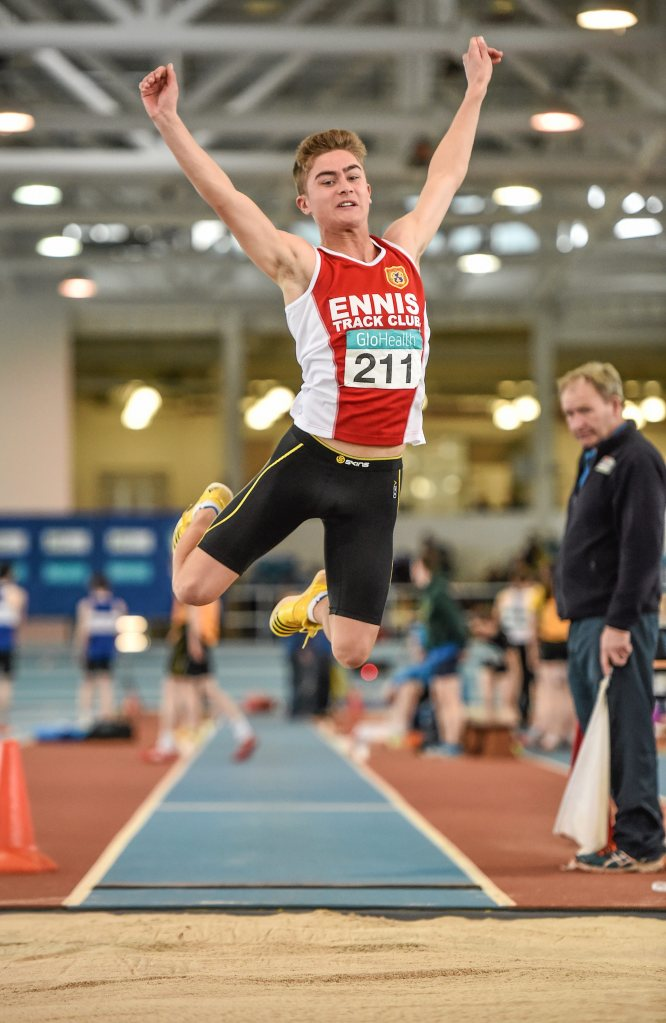 Cathal O'Brien, Ennis Track AC, in action during the Boy's Under 17 Long Jump event during day three of the GloHealth Juvenile Indoor Track and Field Championships. Athlone International Arena, Athlone, Co.Westmeath. Picture credit: Ramsey Cardy / SPORTSFILE