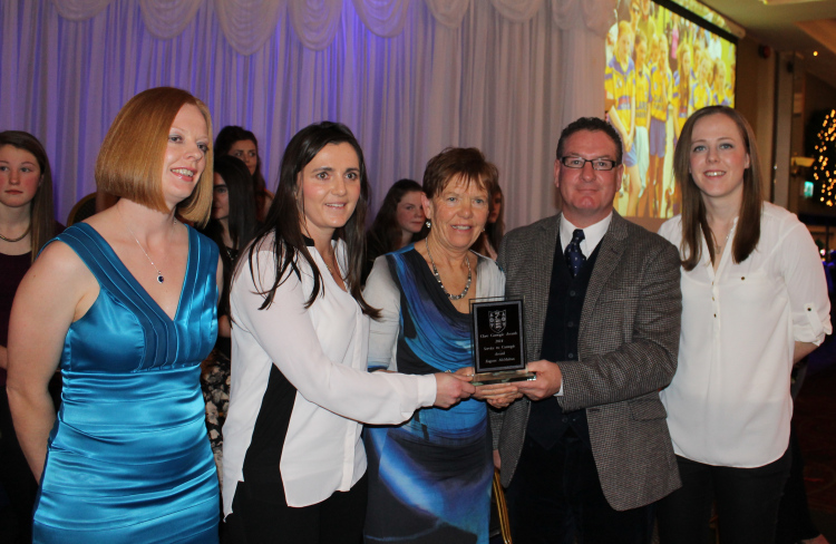 Claire and Anne McMahon, representing Eugene McMahon, accept the Lifetime Achievement Award from Deirdre Murphy, Joe Robbins and Maire Mc Grath. Courtesy Clare Camogie.