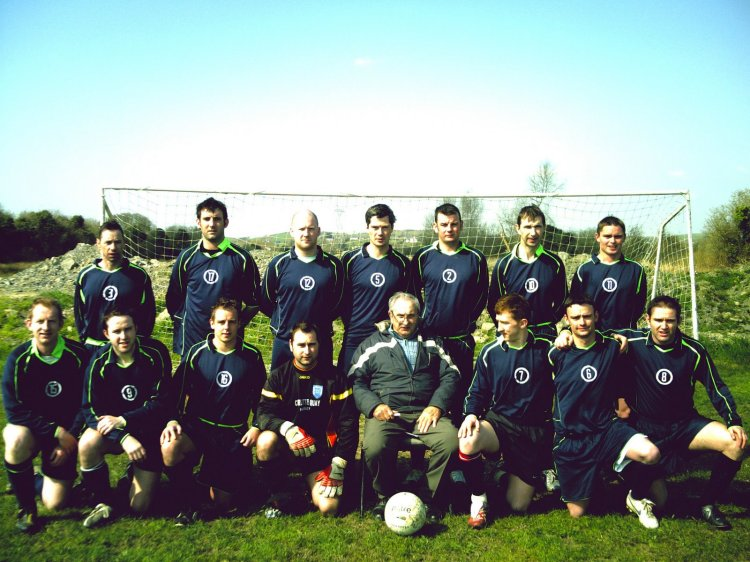 Frank Healy pictured front centre as manager of Kilmaley United in 2006. (Back L-R): Noel Healy, Michael Coughlan, Dave Burke, Jarlath Hassett, Sean O'Loughlin, Tim Healy (Player/Manager), Declan Field (Front L-R): Pat Healy, Mark Dunphy, Mike Weaving, Ger Healy, Frank Healy (Chairman), John Paul Healy, Bernard Field, Shay Dunphy (Captain) Missing from photo: Alan Hehir, Jiri Knapcik, Gareth Thompson, Mark O'Keeffe, Tom Reynolds (Secretary)