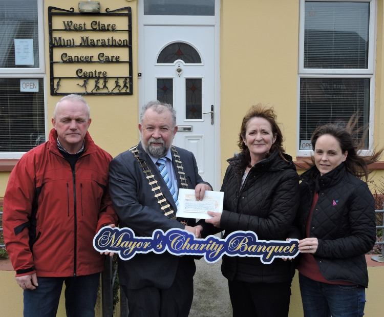 The Cathaoirleach of Clare County Council, Cllr. John Crowe presenting a cheque Willie McGrath, Mary McGrath and Lorraine Lynch at the West Clare Mini Marathon Cancer Care Centre, Kilkee from the proceeds of €24,760 from the recent Mayor's Charity Banquet at Treacy's West County Hotel. The beneficiaries included Carrigoran Day Care Centre, Slainte an Chláir and the West Clare Mini Marathon Cancer Care Centre.