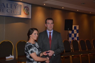 Lisa Kennedy accepts her Senior medal from Seanie McMahon.