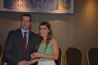Aisling Darcy receives her County medal from Seanie McMahon.