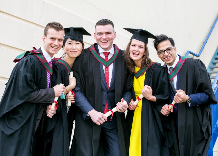 Graduates L-R Alexander Leccadito, Seychelles, Crystal Zhang, China, Ciaran Burns, Ennis Co Clare, Emma fagan, Sandymount Dublin and Ahsan Shamsi, India,  celebrate graduating at the Shannon College of Hotel Management in Shannon Co Clare on Thursday.Pic Arthur Ellis.