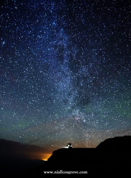 The Milky Way illuminates the sky over O'Brien's Tower and the Cliffs of Moher, Co. Clare. Pic Niall Cosgrove Ennis Photography