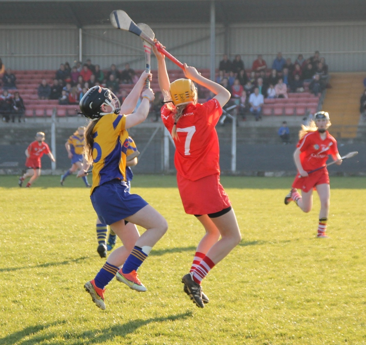 Clare's Aoife Power battles for the high ball with Cork's Maeve Lynch.
