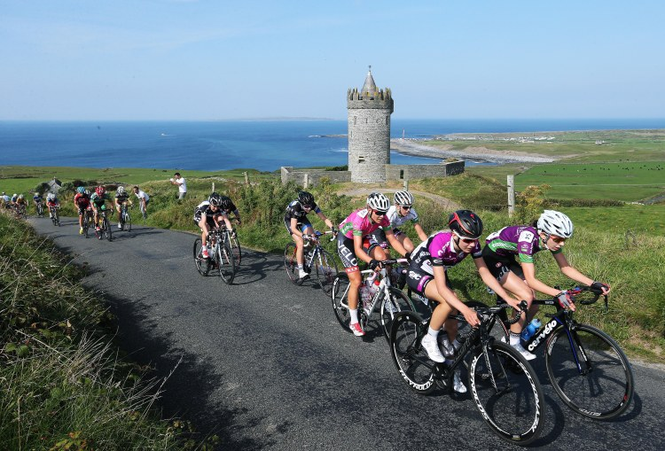Race leader Tayler Wiles in pink stays at the head of the race up Castle Hill at Doonagore Picture: Lorraine O'Sullivan