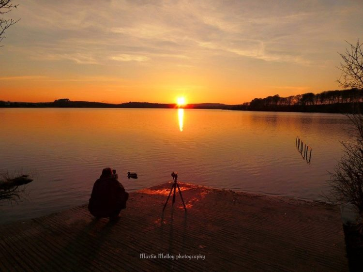 Martin Molloy Photography getting into position to photograph the sunset at Ballyalla Lake, near Ennis, Co. Clare.