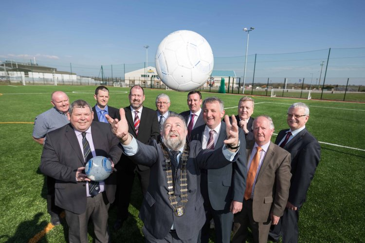 Councillor John Crowe, Cathaoirleach Clare County Council, throws the ball in at the official opening of the state-of-the-art Active Kilrush Sports Complex this week. Also pictured are Eamon Naughton, FAI ,PJ Carmody,Clare County Council, John Corry ,Admin Officer Clare County Council, Tim Forde,General Manager Active Kilrush Sports Complex, Christy O'Malley,  Cllr Ian Lynch , Liam Williams, Chairman Kilrush Sports Complex Managment Committee ,Pat Breen TD, Gabriel Keating and Tom Coughlan, CEO Clare County Council. Photograph by Eamon Ward