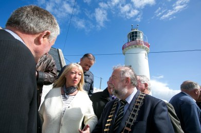 Pictured is Anne Doyle chatting with Cathaoirleach of Clare County Council John Crowe and former Lighthouse keepers.Pic Arthur Ellis.