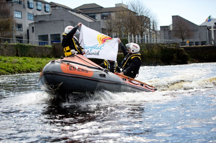 Limerick Search and Rescue team Karen Keehan and Billy Cantillon help host the flag to announce details of Ireland's Ireland's largest BBQ competition, action and adventure on the River Shannon and a spectacular fireworks display will take place as part of Limerick's Riverfest 2015. Pic Sean Curtin Photo.