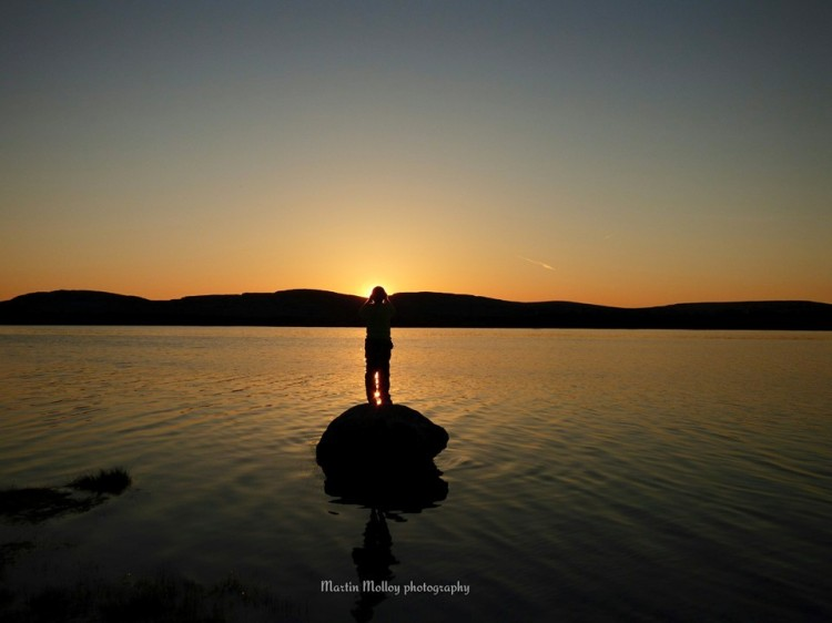 Scott Molloy from Ennis watching the sunset at Lough Bunny, Co. Clare this evening. Pic Martin Molloy Photography